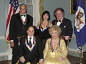 Group photo of the 2002 Kennedy Center Honorees, clockwise from lower right, actress Elizabeth Taylor, singer Paul Simon, actor James Earl Jones, theater actress Chita Rivera, and conductor James Levine taken at the United States Department of State in Washington, D.C. on Saturday, December 7, 2002. They are honored for their lifetime contributions to American culture through the performing arts..Credit: Robert Trippett - Pool via CNP