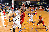 21 January 2012:  FIU center Gilles Dierickx (15) attempts to block a shot by FAU guard-forward Andre Mattison (4) in the first half as the Florida Atlantic University Owls defeated the FIU Golden Panthers, 66-64, at the U.S. Century Bank Arena in Miami, Florida.
