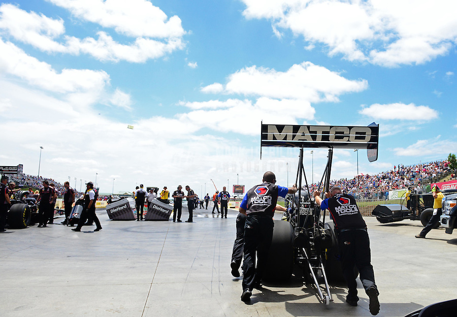 May 20, 2012; Topeka, KS, USA: Crew members push the car of NHRA top fuel dragster driver Antron Brown during the Summer Nationals at Heartland Park Topeka. Mandatory Credit: Mark J. Rebilas-