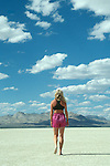 Woman walking accross the playa in the Black Rock Desert