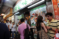 Customers queue outside Tim Ho Wan the cheapest (and probably smallest) Michelin starred restaurant in the world, Hong Kong..17-Jul-11..Photo by Richard Jones......