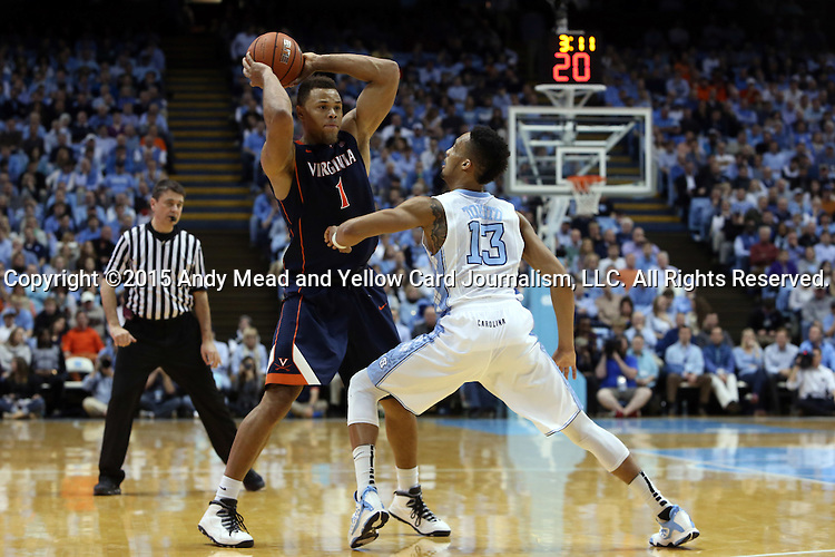 02 February 2015: Virginia's Justin Anderson (1) and North Carolina's J.P. Tokoto (13). The University of North Carolina Tar Heels played the University of Virginia Cavaliers in an NCAA Division I Men's basketball game at the Dean E. Smith Center in Chapel Hill, North Carolina. Virginia won the game 75-64.