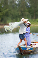 A fisherman casts his net on the Thu Bon River near Hoi An I.