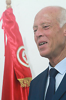 16 September 2019, Tunisia, Tunis: Independent presidential candidate Kais Saied, Tunisian jurist and professor of constitutional law, kisses the Tunisian national flag. Saied and media magnate Nabil Karoui, who was arrested last month on charges of money laundering and tax evasion, are set to face a run-off after a hotly-contested Tunisian presidential election that saw 26 contenders vying for the job, according to preliminary results from the electoral commission on Monday<br /> <br /> PHOTO : Agence Quebec Presse -  JDIDI_WASSIM