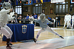 12 February 2017: Duke's Haley Fisher (right) lunges at Boston College's Gabrielle Chau (left) during Saber. The Duke University Blue Devils hosted the Boston College Eagles at Card Gym in Durham, North Carolina in a 2017 College Women's Fencing match. Duke won the dual match 19-8 overall, 6-3 Foil, 5-4 Epee, and 8-1 Saber.