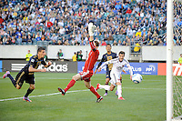 Sebastien Le Toux (9)  of the Philadelphia Union scores the first goal of the game past D. C. United goalkeeper Troy Perkins (23) in the fourth minute during a Major League Soccer (MLS) match at Lincoln Financial Field in Philadelphia, PA, on April 10, 2010.