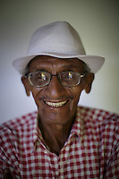 80 years-old Cuban  Coki  who prepares to leave Cuba for the first time in his life, towards the USA. Once more Cubans are experimenting deep turns in their scattered economy. A photo essay by Lorenzo Moscia with available story by Colette Rodriguez Marcano.