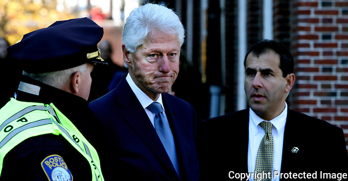 President Clinton at Faneuil Hall before the start of the Thomas Menino's funeral procession on November 3, 2014.<br /> (Photo by Gary Wilcox)