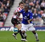 Sunderland's Dean Whitehead and Everton's Yakubu. during the Premier League match at the Stadium of Light, Sunderland. Picture date 9th March 2008. Picture credit should read: Richard Lee/Sportimage