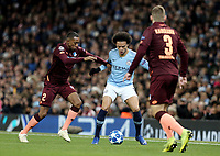 Manchester City's Leroy Sane holds off the challenge from 1899 Hoffenheim's Joshua Brenet <br /> <br /> Photographer Rich Linley/CameraSport<br /> <br /> UEFA Champions League Group F - Manchester City v TSG 1899 Hoffenheim - Wednesday 12th December 2018 - The Etihad - Manchester<br />  <br /> World Copyright © 2018 CameraSport. All rights reserved. 43 Linden Ave. Countesthorpe. Leicester. England. LE8 5PG - Tel: +44 (0) 116 277 4147 - admin@camerasport.com - www.camerasport.com