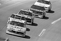 #43 Pontiac driven by Richard Petty leads a pack of cars during the DieHard 500, NASCAR Winston Cup race, Talladega Superspeedway, July 26, 1992.  (Photo by Brian Cleary/bcpix.com)