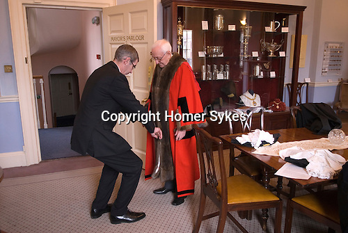 Hercules Clay Penny Loaf Day. The Mayor of Newark Tom Bickley, being robed up, before meeting guests. Newark-on-Trent,  Nottinghamshire UK 2015.<br />