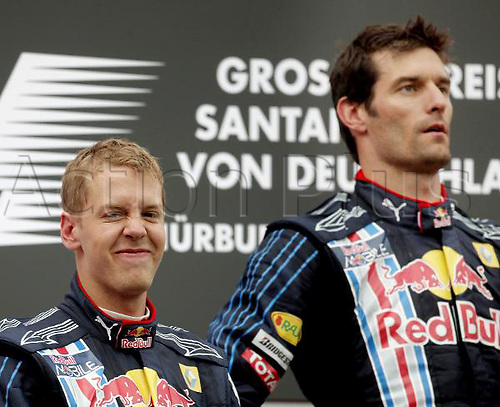 Second placed German Formula One driver Sebastian Vettel (l) stands on the podium with his teammate and winner Australian Mark Webber at the Nuerburgring in Nuerburg, Germany, 12 July 2009. Photo: FELIX HEYDER/ActionPlus UK Licenses Only