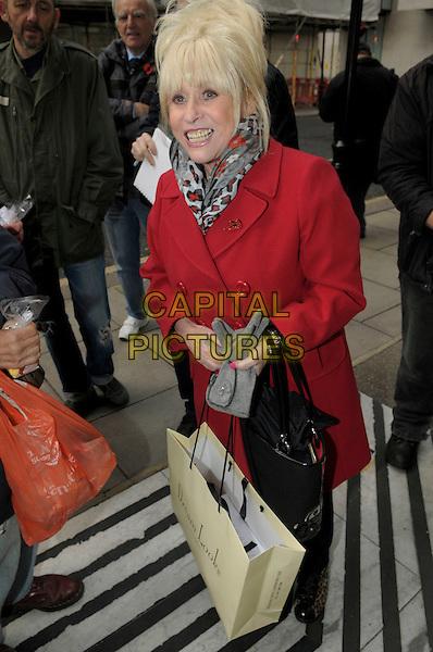 Dame Barbara Windsor .at BBC Radio 2, London, England, UK, .1st November 2012..full length red coat bag handbag shopping leopard print trainers animal scarf .CAP/IA.©Ian Allis/Capital Pictures.