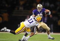 Sept. 5, 2009; Seattle, WA, USA; Washington Huskies quarterback (10) Jake Locker runs as he is tackled by LSU Tigers linebacker (11) Kelvin Sheppard at Husky Stadium. LSU defeated Washington 31-23. Mandatory Credit: Mark J. Rebilas-