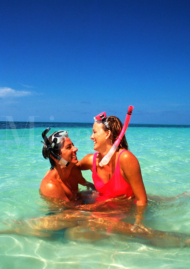 Couple with snorkeling equipment