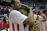 Winston-Salem Prep's Mike Hughes, left, hugs teammate Kerry Campbell after the Phoenix beat Plymouth for the State Championship at the Dean Smith Center in Chapel Hill, NC, on Saturday, March 10, 2012.  Photo by Ted Richardson