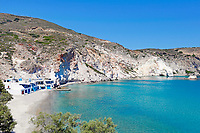 "Traditional fishermen houses with the impressive boat shelters, also known as ""syrmata"" in Firopotamos of Milos, Greece"