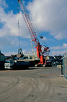A728WB Red crane unloading ship's cargo and loading a lorry Great Yarmouth post Norfolk England