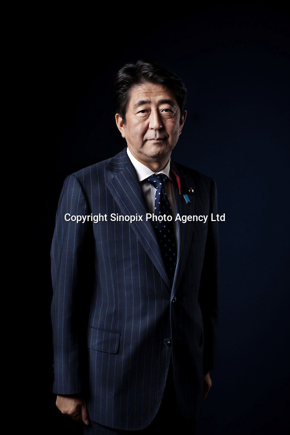 Japanese Prime Minister Shinzo Abe poses for a portrait photograph inside the prime minister's official residence in Tokyo, Japan, on Friday, Oct. 4, 2013. (Photo/ Ko Sasaki for FT )
