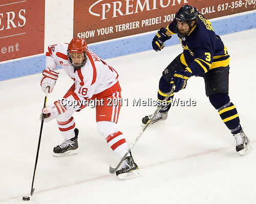 Wade Megan (BU - 18), Kyle Bigos (Merrimack - 3) - The visiting Merrimack College Warriors defeated the Boston University Terriers 3-2 in overtime on Friday, November 11, 2011, at Agganis Arena in Boston, Massachusetts.
