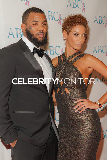 BEVERLY HILLS, CA, USA - NOVEMBER 22: The Game, Nicole Mitchell Murphy arrive at the Associates For Breast And Prostate Cancer Studios 25th Annual Talk Of The Town Black Tie Gala held at The Beverly Hilton Hotel on November 22, 2014 in Beverly Hills, California, United States. (Photo by Rudy Torres/Celebrity Monitor)