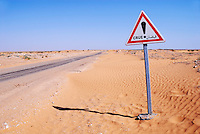 Flood warning sign on desert road, Tunisia, Ksar Ghilane, Sahara Desert