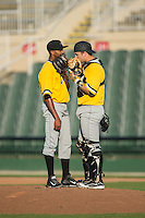 West Virginia Power catcher Taylor Gushue (17) has a chat on the mound with relief pitcher Junior Lopez (19) during the game against the Kannapolis Intimidators at CMC-Northeast Stadium on April 21, 2015 in Kannapolis, North Carolina.  The Power defeated the Intimidators 5-3 in game one of a double-header.  (Brian Westerholt/Four Seam Images)