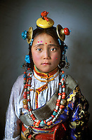 "Kham,Tibet<br /> This photo was featured in the magazine and made the cover the Taschen book celebrating 125 Years of National Geographic as well as my book, ""Face to Face: Portraits of the Human Spirit.""<br /> I have been drawn to Tibet ever since I was child. When I moved to Nepal I discovered there were 120,000 refugees living throughout India and Nepal. I visited all 47 Tibetan refugee settlements and became consumed with documenting how the Tibetan people in exile have managed to maintain their culture despite not having a country.<br /> I have since made dozens of trips into Tibet, deep into the countryside as I follow the nomads. The photos and interviews became the basis of my Masters these in Visual Anthropology at U.C. Berkeley and two of my books, ""The Spirit of Tibet"" and ""The Dalai Lama, A Simple Monk.""<br /> On this particular trip I was driving in the remote eastern region of the Tibetan Plateau when I saw this young girl, part of a crowd returning from a horse festival. It was pouring rain, so I brought her to a nearby school to take her photograph She was so small that the light from the window barely reached her; I had to stand her on a desk. Even at the age of four, she had a face that seemed to express the underlying sadness of a culture that has been so challenged. Yet she had a look of resilience and tenacity well beyond her years."
