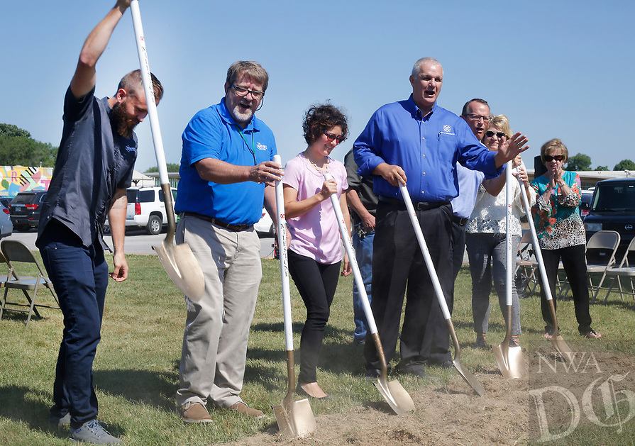 NWA Democrat-Gazette/DAVID GOTTSCHALK Tim Babcock (from left), with Progressive Bike Ramps,  Mike Gilbert, chief operating officer of the Jones Trust, Karen Minkel, home region program director for the Walton Family Foundation, Mayor Doug Sprouse and other break ground Tuesday, June 5, 2018, following the announcement of the creation of The Runway Bicycle Skills Park at the Jones Center in Springdale. The park will have the largest asphalt pump track in North America and will host the Pump Track (bicycling) World Championships sponsored by Red Bull in October.