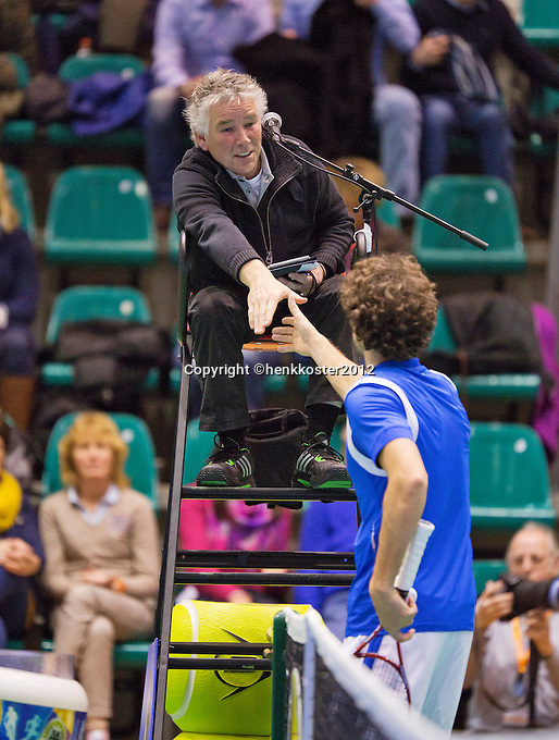 13-12-12, Rotterdam, Tennis Masters 2012, Robin Haase   shakes hands with the umpire