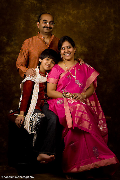 Jun 19, 2011; San Antonio, TX, USA; Studio portrait of family with son smiling.  Photo by San Antonio Wedding & Portrait Photographer Soobum Im.