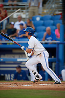 Dunedin Blue Jays second baseman Cavan Biggio (4) follows through on a swing during a game against the St. Lucie Mets on April 20, 2017 at Florida Auto Exchange Stadium in Dunedin, Florida.  Dunedin defeated St. Lucie 6-4.  (Mike Janes/Four Seam Images)