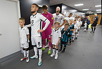Matthew Grimes with team mates and children mascots prior to the Sky Bet Championship match between Swansea City and Cardiff City at the Liberty Stadium, Swansea, Wales, UK. Sunday 27 October 2019