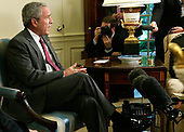 Washington, D.C. - June 14, 2007 -- United States President George W. Bush speaks to the media as he meets with Army Lieutenant General Martin E. Dempsey, former Commanding General of Multi-National Security and Transition Command Iraq, in the Oval Office of the White House, Thursday, June 14, 2007 in Washington, DC. Army Lieutenant General James Dubik has succeeded Dempsey to take over the command on June 10, 2007 in Baghdad.  <br /> Credit: Alex Wong - Pool via CNP