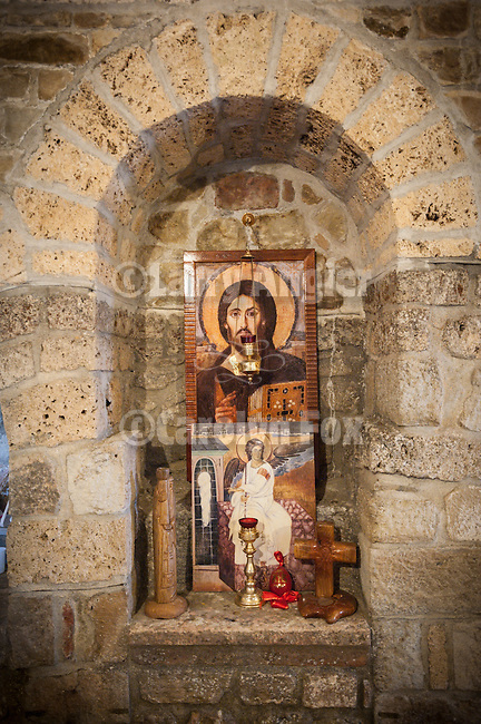 Icons with vigil lamp, Djurdjevi Stupovi monastery near Novi Pazer..Djurdjevi Stupovi Manastir..(English: The Tracts of Saint George, often incorrectly translated as The Pillars of Saint George) is a 12th-century Eastern Orthodox monastery located in the vicinity of today's city of Novi Pazar, in the Ra?ka region of Serbia. The church was erected by the Grand Prince of Rascia, Stefan Nemanja, back in 1166, on the spot where the Serbian medieval capital of Ras once stood. It is currently undergoing reconstruction and renovation. Djurdjevi  stupovi have entered a UNESCO list together with the complex of Stari Ras and Sopocani...--Novi Pazar--Olga Pleshkova, Miloje, Zica.