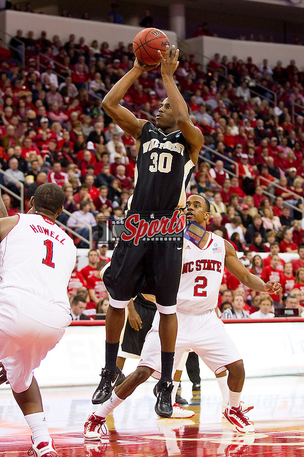 Travis McKie #30 of the Wake Forest Demon Deacons takes a jump shot during second half action against the North Carolina State Wolfpack at the RBC Center on January 8, 2011 in Raleigh, North Carolina.  The Wolfpack defeated the Demon Deacons 90-69.  Photo by Brian Westerholt / Sports On Film