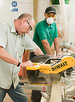 Using a powerful circular saw to cut wood quickly and accurately.  Able Skills in Dartford, Kent, runs courses in construction industry skills like, bricklaying, carpentry and tiling.