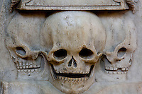 Skulls, detail of the Funerary Column of the Heart of Francis II (1544 - 1560), marble porphyry, 1562 - 1570, by Francesco Primaticcio (architect), Jacquio Ponce (sculptor), Jean Leroux (sculptor), Abbey church of Saint Denis, Seine Saint Denis, France. Picture by Manuel Cohen