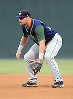 First baseman Tyler Burnett (12) of the Lexington Legends, Class A affiliate of the Houston Astros, in a game against the Greenville Drive on August 5, 2011, at Fluor Field at the West End in Greenville, South Carolina. (Tom Priddy/Four Seam Images)