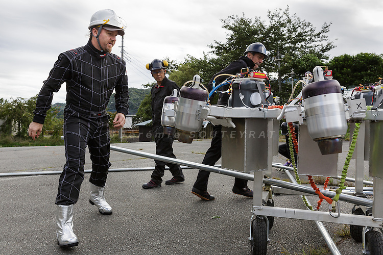 Minakami, Gunma prefecture, Japan, September 29 2016 - Beau Retallick is an Australian citizen based in Japan and the founder of Bungy Japan, a pioneer bungy jumping company in Japan. Beau Retallick is also an inventor and uses the money earned from bungy jumping to various projects. His latest invention is a jet powered drone with enough thrust to levitate a sumo wrestler.<br /> Beau Retallick and his team testing the drone on the parking lot of the bungy jumping company.