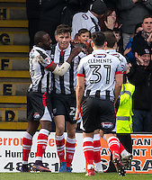 Calum Dyson (2nd left) of Grimsby Town celebrates his goal with teammates during the Sky Bet League 2 match between Grimsby Town and Wycombe Wanderers at Blundell Park, Cleethorpes, England on 4 March 2017. Photo by Andy Rowland / PRiME Media Images.