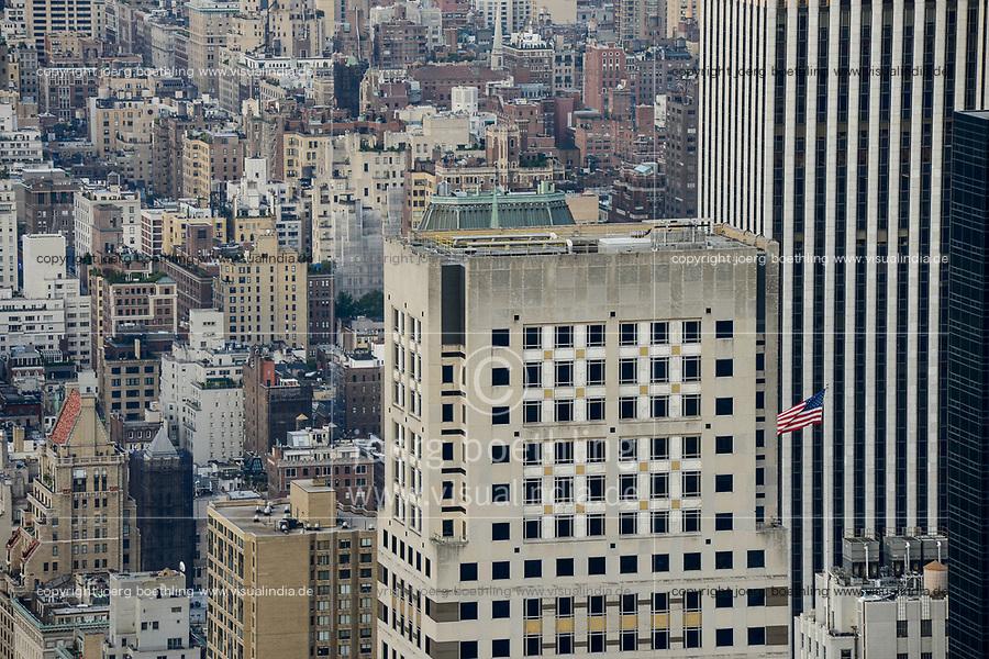 USA, New York City, Manhattan, skyscraper with US flag