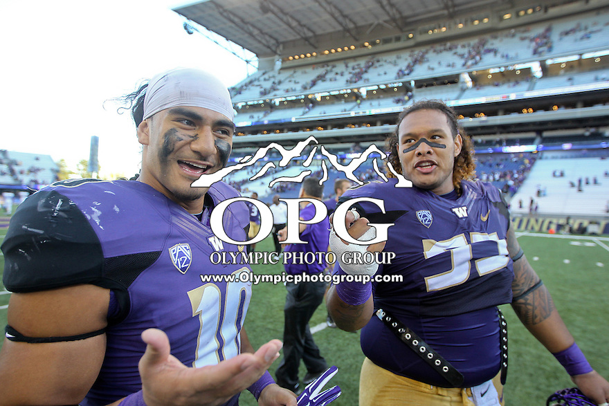Sept 20, 2014:  Washington's #55 Danny Shelton does a mock interview with #10 John Timu after the game against Georgia State.  Washington defeated Georgia State 45-14 at Husky Stadium in Seattle, WA.