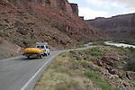 Van pulling whitewater raft on Highway 128 along the Colorado River near Moab, Utah, USA.