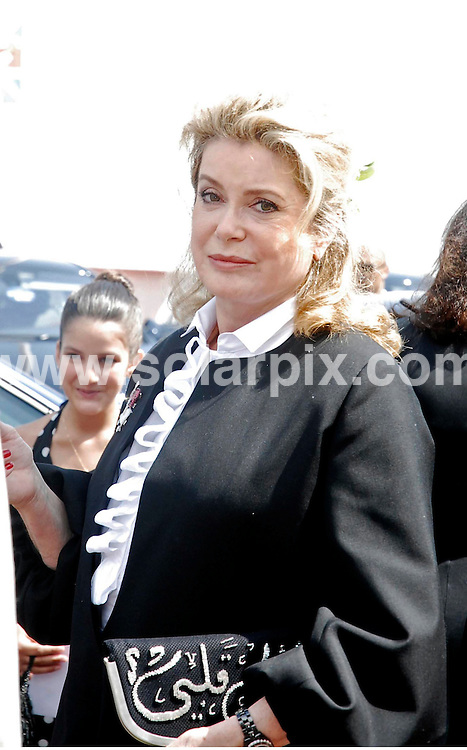 **ALL ROUND PICTURES FROM SOLARPIX.COM**.**WORLDWIDE SYNDICATION RIGHTS**.Catherine Deneuve out and about at the 60th Cannes Film Festival,Cannes,France.23 May 2007...JOB REF: 3986         JWC        DATE:23.5.07.**MUST CREDIT SOLARPIX.COM OR DOUBLE FEE WILL BE CHARGED* *UNDER NO CIRCUMSTANCES IS THIS IMAGE TO BE REPRODUCED FOR ANY ONLINE EDITION WITHOUT PRIOR PERMISSION*