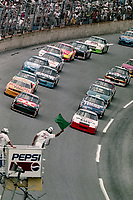 DAYTONA BEACH, FL - JUL 2, 1994:  The green flag waves on a restart during the Pepsi 400 NASCAR Winston Cup race at Daytona International Speedway, Daytona Beach, FL. (Photo by Brian Cleary/www.bcpix.com)
