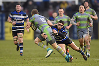 Darren Atkins of Bath Rugby tackles Alex Tait of Newcastle Falcons. Anglo-Welsh Cup match, between Bath Rugby and Newcastle Falcons on January 27, 2018 at the Recreation Ground in Bath, England. Photo by: Patrick Khachfe / Onside Images
