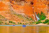 Whitewater rafting trip (oar trip) on the Colorado River in Marble Canyon passing a waterfall near Redwall Cavern, Grand Canyon National Park, Arizona USA