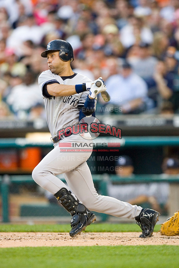 Derek Jeter #2 of the New York Yankees follows through on his swing versus the Detroit Tigers at Comerica Park April 27, 2009 in Detroit, Michigan.  Photo by Brian Westerholt / Four Seam Images